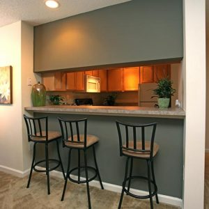 Model unit breakfast bar featuring modern furniture and decor