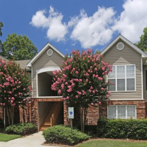 Building Exterior with Crepe Myrtles in Bloom